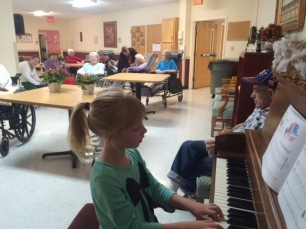 Mallori playing for Valley View residents